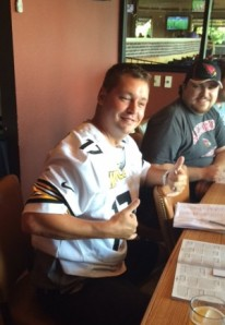 Packers Fanatic and Dynasty Owner sporting a Steelers Jersey after losing a bet. he may be smiling on the outside but he was not pleased.